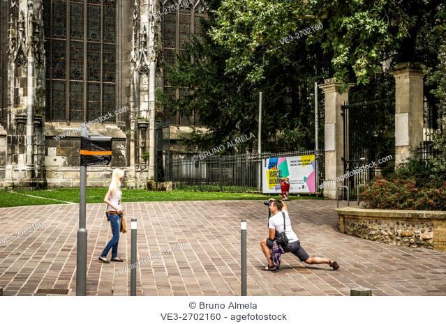 Tourist taking a picture in Saint-Ouen Abbey, Rouen (department of Seine-Maritime, region of Normandie, France)