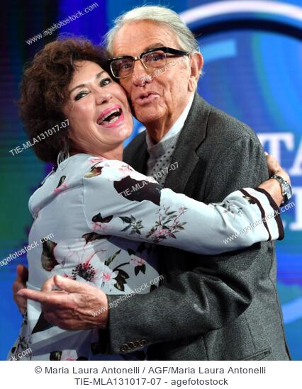 The actress Corinne Clery with the press agent Enrico Lucherini during the tv show Porta a porta about the scandal on the producer Harvey Weinstein, Rome