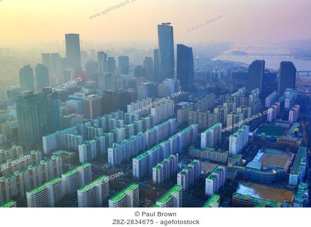 General view of blocks of flats and the Seoul city skyline at dusk in Seoul, Korea