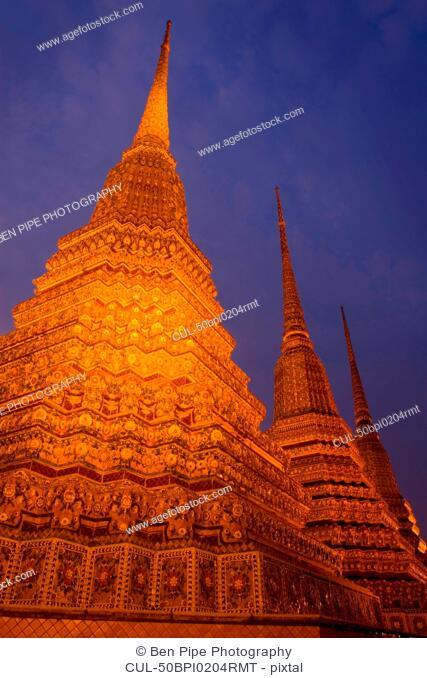 Ornate carved spires lit up at night