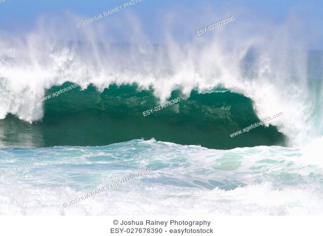 Large waves break off the north shore of oahu hawaii during a great time for surfers surfing. These waves have hollow barrells and are located at pipeline by...