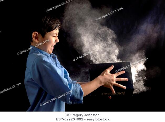 A young boy slams a book with powder in it in this conceptual image