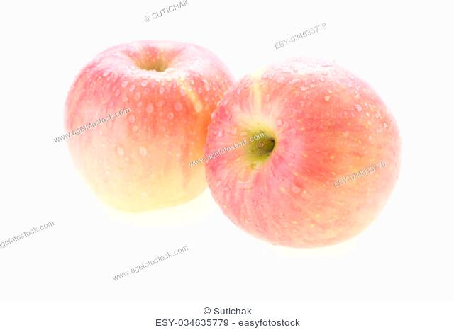 apple fuji fruit with water drops isolated on white background