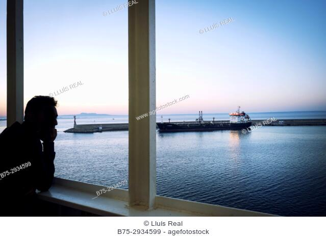 Silhouette of unrecognizable man on the deck of a ferry boat in port. Mediterranean Coast, Palma, Majorca, Balearic Islands, Spain