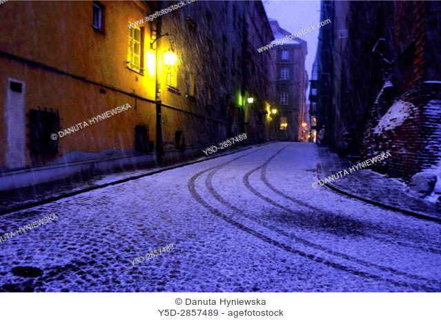 Warsaw Old Town in heavy snowfall at night, Warsaw, Poland, Europe
