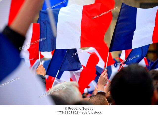 Macron supporters celebrate his victory outside the Louvre museum in Paris,France