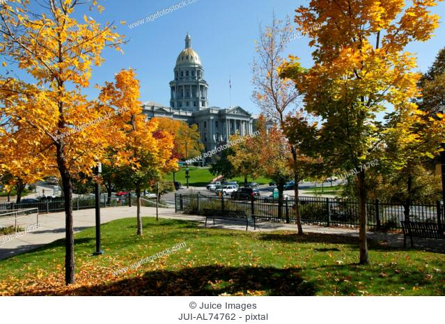View of the Capitol Building slightly obscured by autumn trees, Denver, Colorado, USA