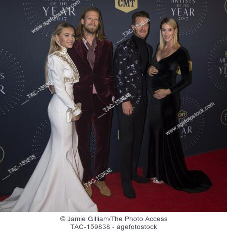NASHVILLE, TN - Brian Kelley and Tyler Hubbard of Florida Georgia Line along with wives Brittney Marie Cole and Hayley Stommel arrive on the red carpet at the...