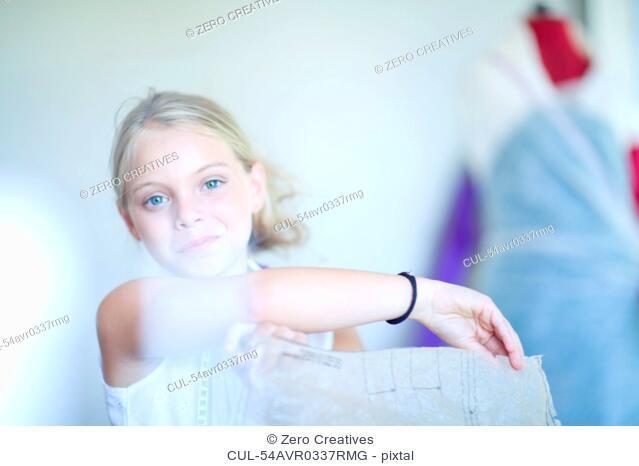 Girl playing fashion designer