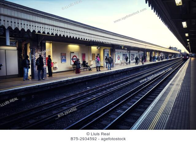 People in the platform of Upton Park underground station. Upton Park, East London, London, England, UK