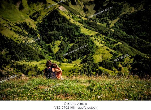Mother and son near Sanctuary of Notre-Dame of La Salette (Isére department, Region of Auvergne-Rhône-Alpes, France)