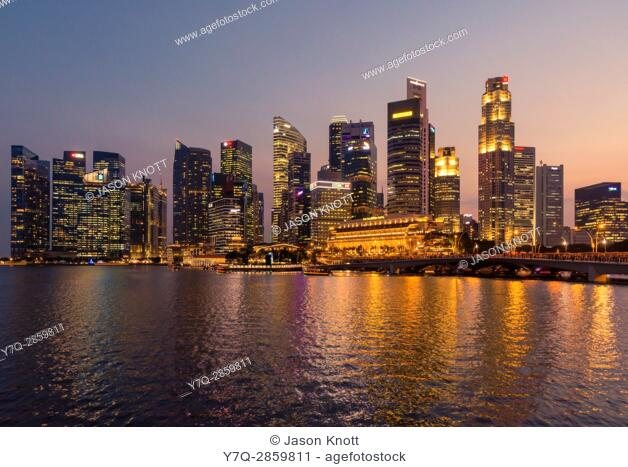 Sunset over the skyscrapers of the downtown core CBD and Marina Bay, Singapore