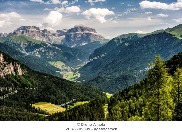 View of Campitello di Fassa and dolomites Sella Group from Catinaccio-Rosengarten Group. The peak in the background is Piz Boé, (Autonomous Province of Trento