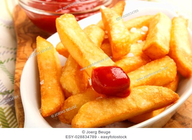 tasty french fries with tomato ketchup in a bowl