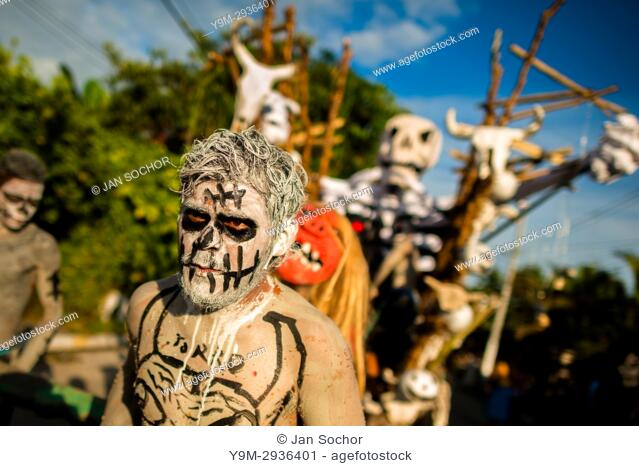 Young Salvadoran men, painted an ashen grey, perform indigenous mythology characters in the La Calabiuza parade at the Day of the Dead celebration in...