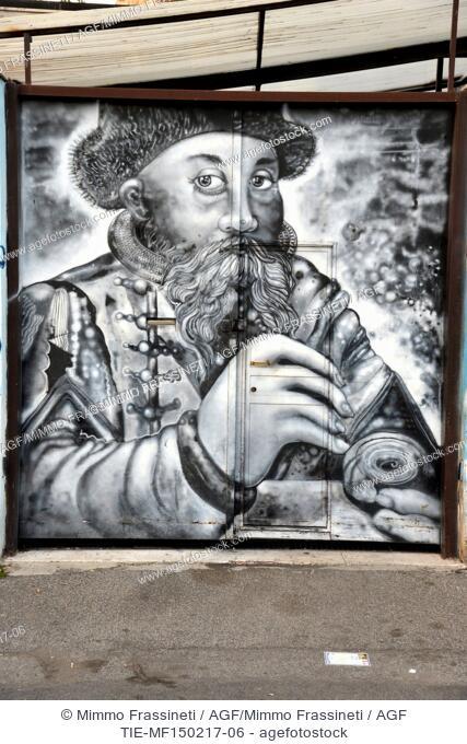 Street art in the Pigneto district, Braccio da Montone Street. Murale with portrait of Gutemberg by Studio Sotterraneo (Carlos Atoche) ,Rome, ITALY-15-02-2017