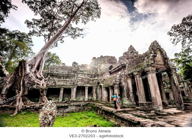 Locals in Preah Khan Temple in Angkor, which is located near Siem Reap (province of Siem Reap, Cambodia)