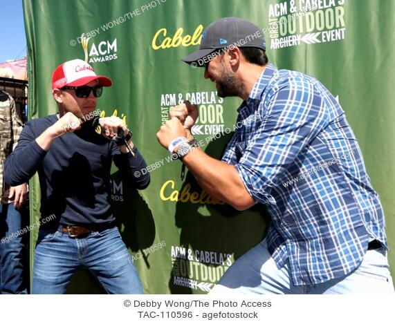Justin Moore (L) and Luke Bryan attend the Cabela's & Academy of Country Music Celebrity Archery Tournament during the 4th ACM Party for a Cause Festival at the...