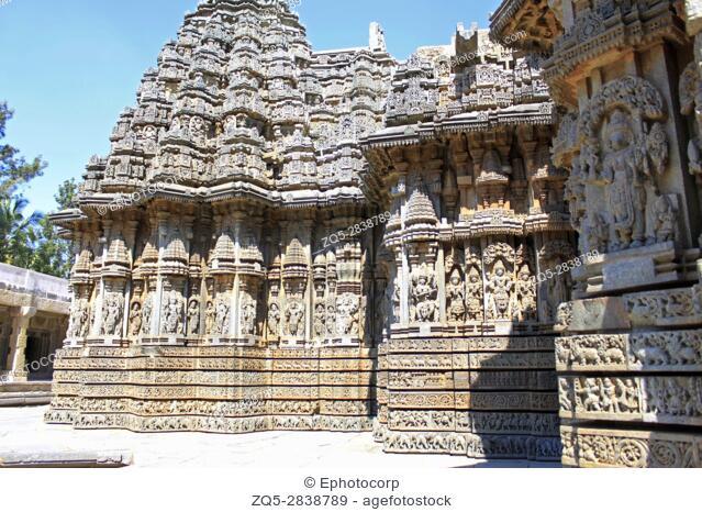 Close up of deity sculpture Vishnu and Lakshmi on Garuda under eves on shrine outer wall in the Chennakesava Temple, Hoysala Architecture at Somnathpur