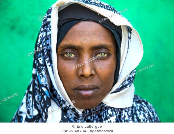 Portrait of an Afar tribe woman with green eyes and tattoos on her face, Afar region, Assaita, Ethiopia