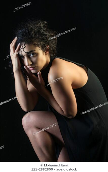 Beautiful young woman wearing a black dress