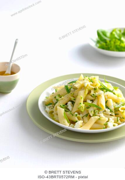 Bowl of pasta with cheese and herbs