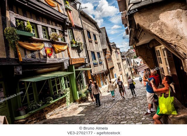 Tourists in Jerzual street, Dinan (department of Côtes-d'Armor, region of Bretagne, France)