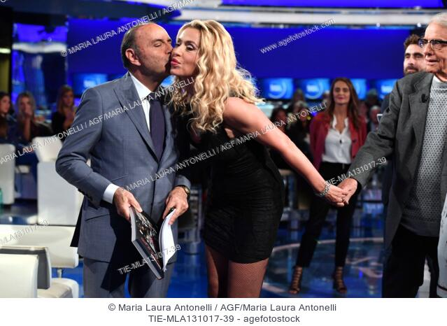The showgirl Valeria Marini with the tv presenter Bruno Vespa during the tv show Porta a porta about the scandal on the producer Harvey Weinstein, Rome