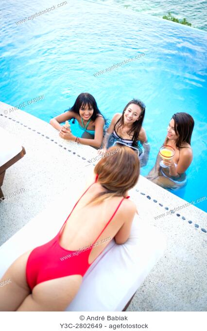 Infinity pool party with four young attractive women, Puerto Vallarta, Mexico