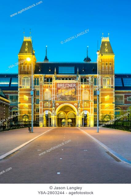 Netherlands, North Holland, Amsterdam. The Rijksmuseum on Museumplein at dusk