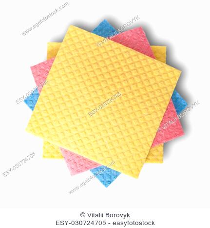 Multicolored sponges for dishwashing in chaotic order top view isolated on white background