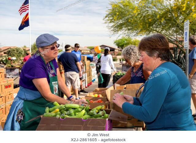Marana, Arizona - Volunteers from St. Christpher Catholic Parish distribute produce provided by the Borderlands Food Bank