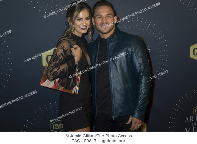 NASHVILLE, TN - Brie Willett and mixed martial artist Michael Chandler arrive on the red carpet at the 2017 CMT Artists of the Year at the Schermerhorn Symphony...