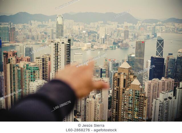 Finger pointing to Kowloon, Hong Kong, China