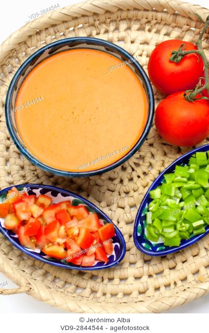 Food. Traditional Andalusian gazpacho with its ingredients. Tomato and green pepper. Andalusia, Spain. Europe