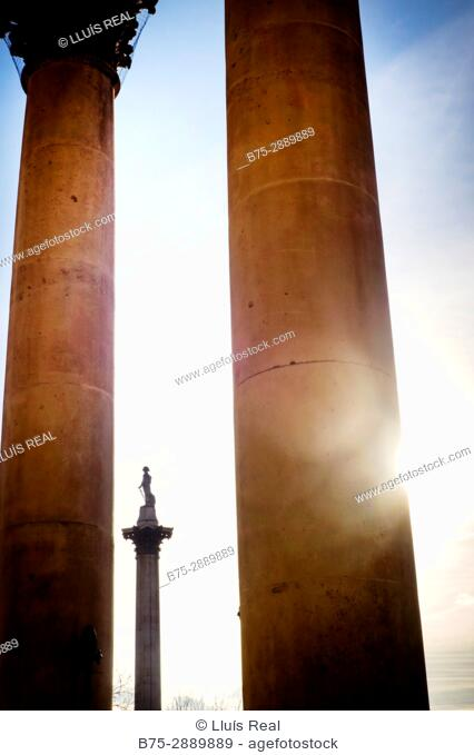 Nelson's Column seen through the columns of St. Martins ch, Trafalgar Square, London, England
