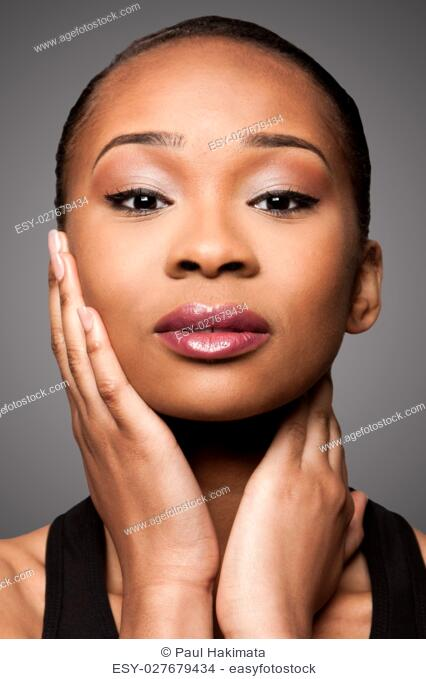 Beautiful face of black Asian blasian woman with cosmetics makeup, skincare concept