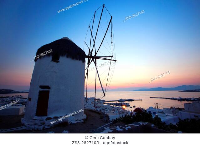 Traditional windmill called Bonis used as Folk Museum on the hill above the town center at the blue hour, Mykonos, Cyclades Islands, Greek Islands, Greece