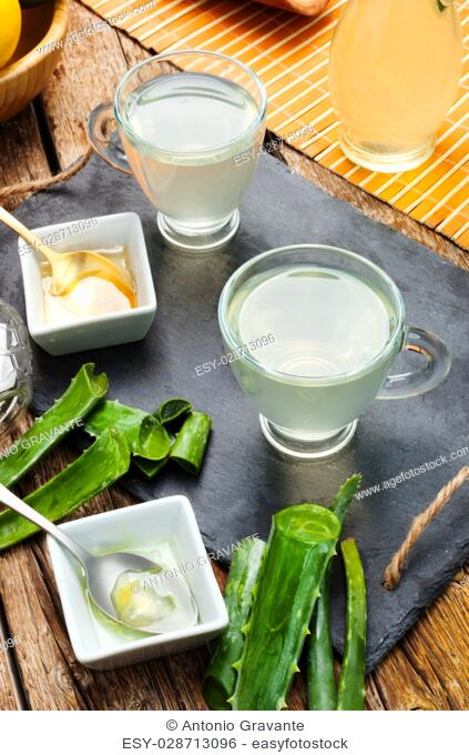 Drink aloe vera and honey. Glass cups on a slate tray