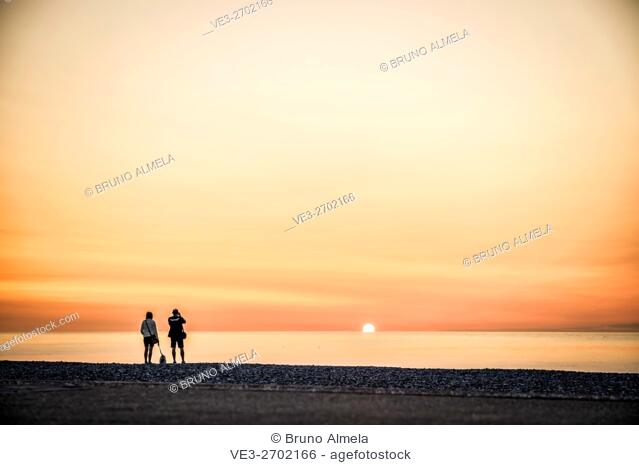 Tourists enjoying the sunset in Veulettes-sur-Mer (department of Seine-Maritime, region of Normandie, France)