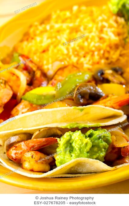 An authentic Mexican food restaurant has plated fajitas ready to serve