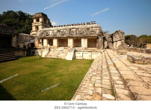 Visitors in front of the Palace-El Palacio at the Patio de los Cautivosin Palenque Archaeological Site, Palenque, Chiapas State, Mexico, Central America