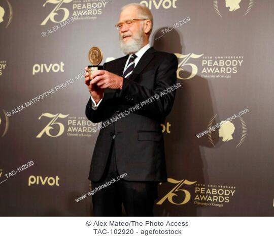 David Letterman poses with his Peabody Award on May 21, 2016 in New York, New York