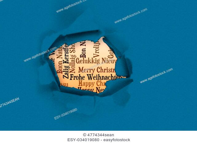 Christmas greetings in sri lankansinhala language stock photo circle hole in paper against holiday greetings in different languages m4hsunfo