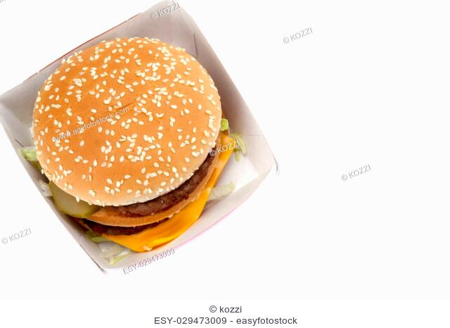 Close-up image of a big hamburger in the cardboard box against the white background