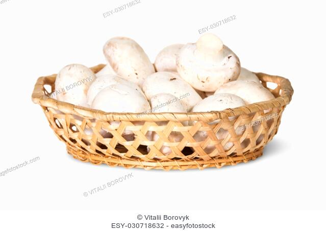 Mushrooms Champignon In A Wicker Basket Isolated On White Background