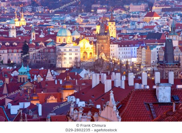 prague - elevated view of spires of the old town and charles bridge at dusk