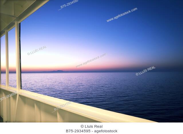 Sunrise seen from the deck of a ferry boat. Mediterranean Coast, Palma, Majorca, Balearic Islands, Spain