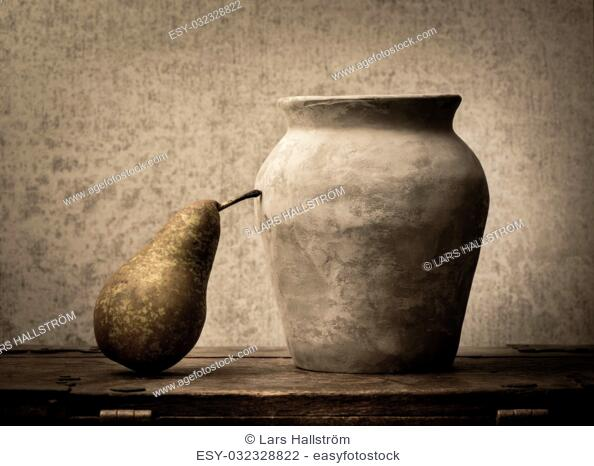 Fruit still life with pear on wooden table. Vintage rustic food image with artistic texture effect