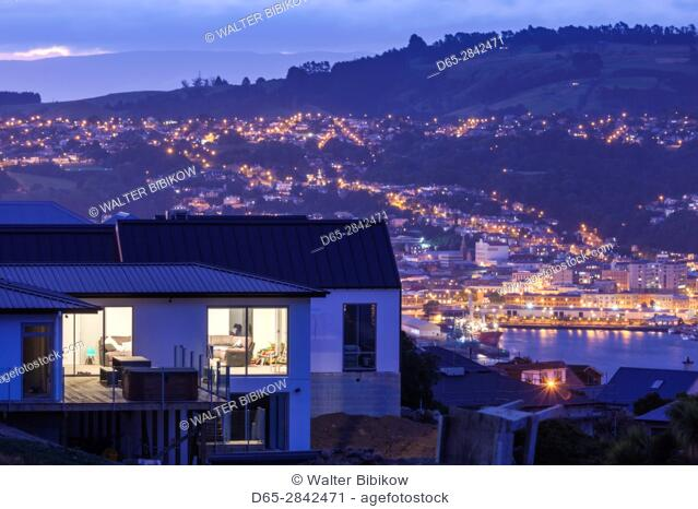 New Zealand, South Island, Otago, Dunedin, elevated city view from the Otago Peninsula, dusk